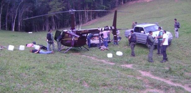 Imagem do dia da apreensão mostra o helicóptero do deputado Gustavo Perrella