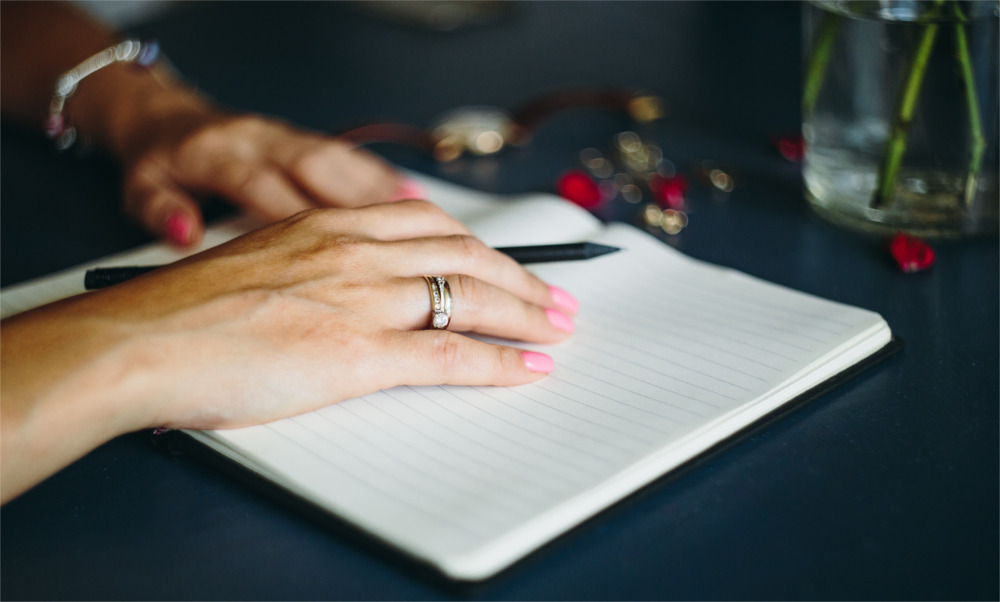 Woman-writing-in-her-notebook.jpg