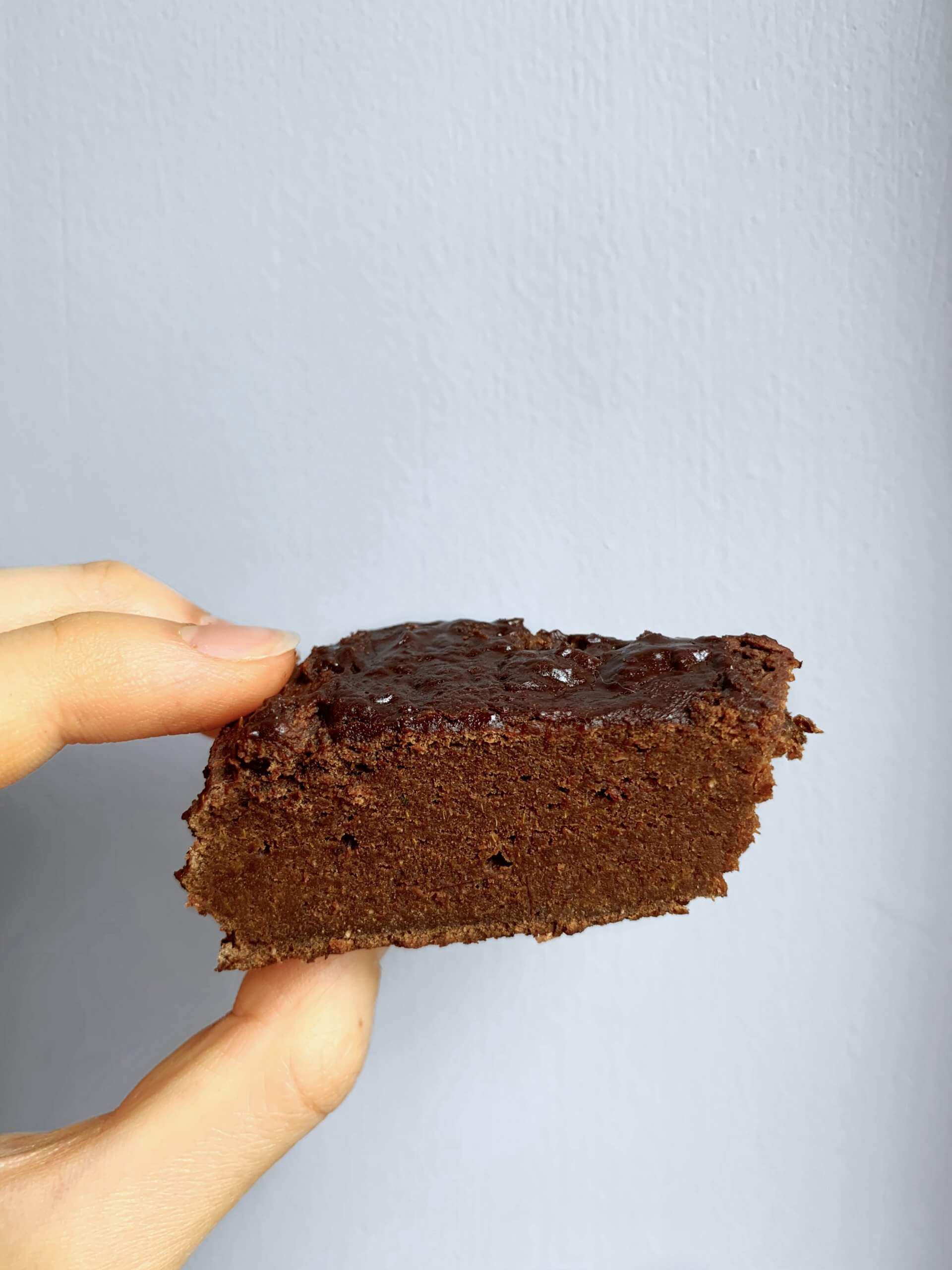 close shot of imheatherr Macro Friendly Protein Fudge Brownies that look like a Chocolate Scone. Low calorie and high protein recipe