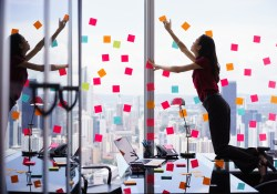 Woman generating ideas with sticky notes