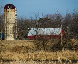 Red Barn with tall silo.