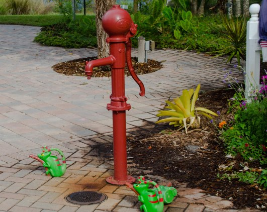Best of all, a short water pump and lots of watering cans.