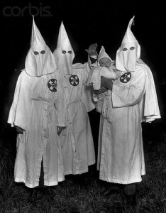 20th century --- Ku Klux Klan Members with Child --- Image by © Bettmann/CORBIS