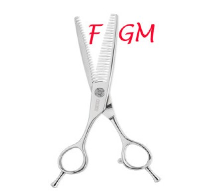 A pair of scissors cutting the letter F away from the letters GM written in red | www.imjussayin.com