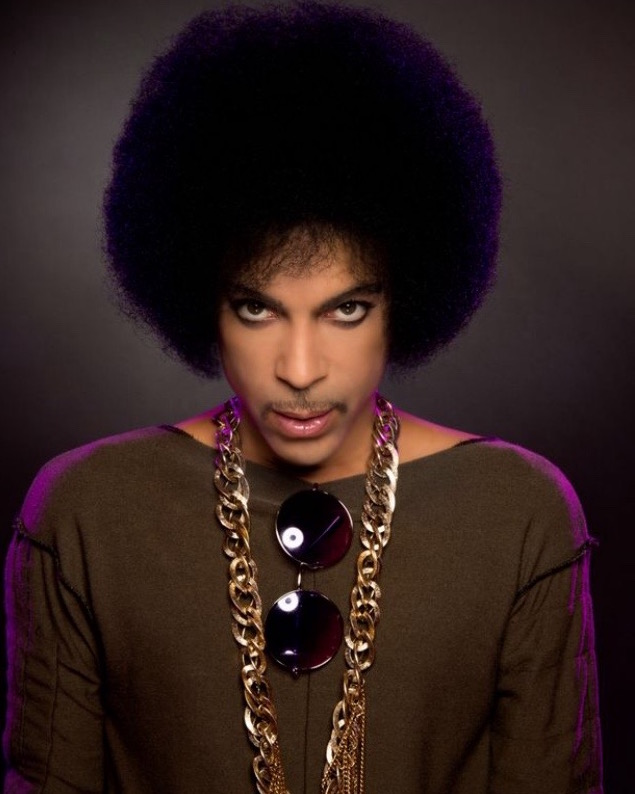 Prince in purple of course - afro and all