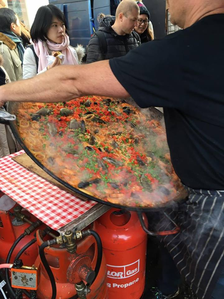 seafood-paella-being-moved