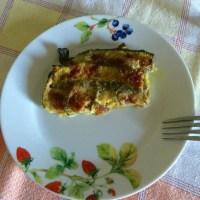 Parmigiana bianca di zucchine con prosciutto crudo e mozzarella