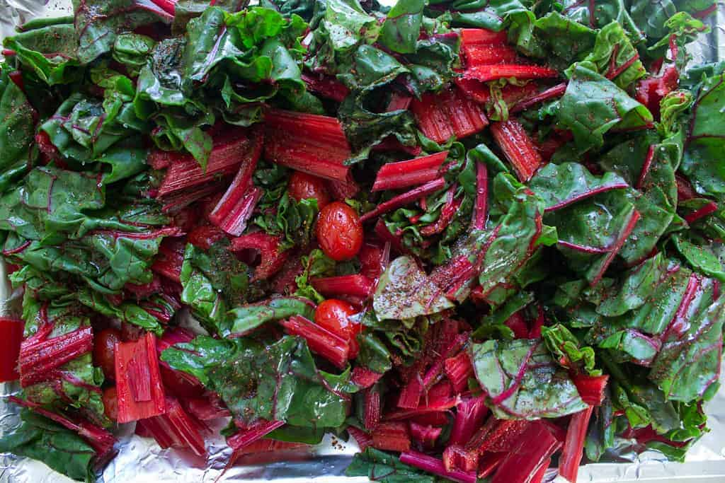 swiss chard and tomatoes ready for oven