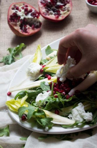 Endive and arugula provide the peppery bite to this arugula salad, while the milky fresh mozzarella brings creaminess, & the pomegranate and pecans the pop.