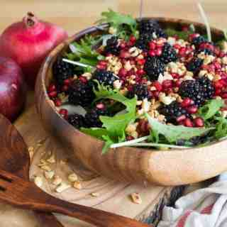 Berry salad with red onions, arugula, nuts and pomegranate arils (V, GF)