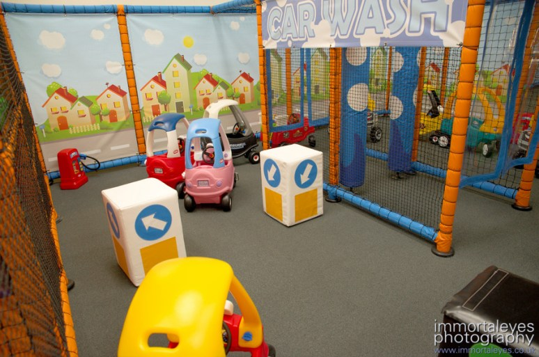 The toddlers' peddle car area with 'car wash'.