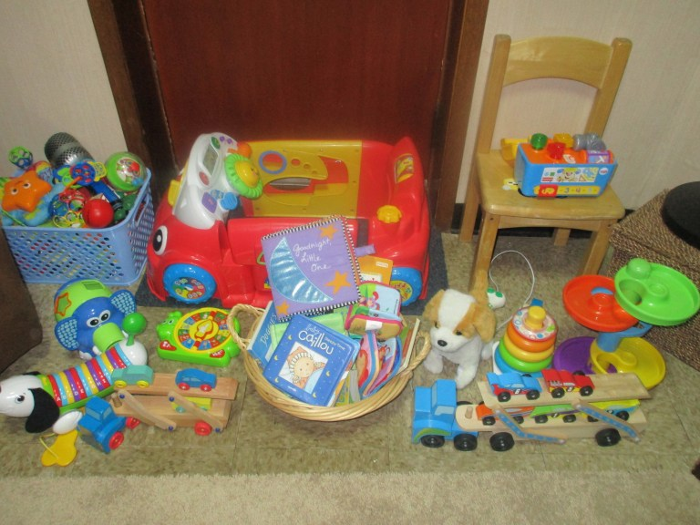 Before, the toys are neatly stacked while the baby sleeps.