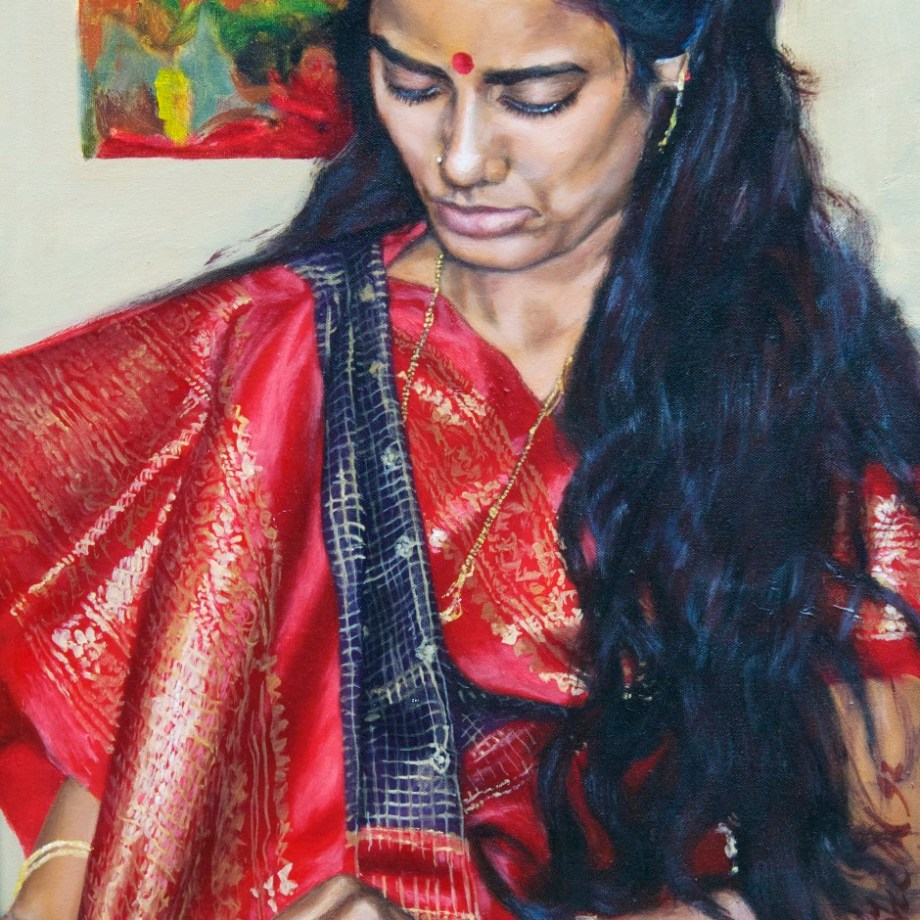 Gold and red sari on black-haired Indian lady