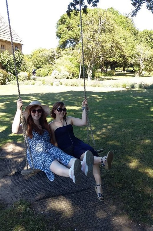 Me and my sister on the swing.