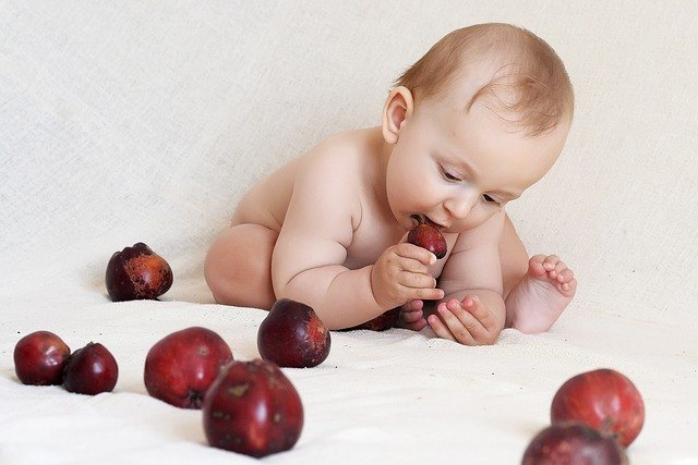 baby grabs fruit