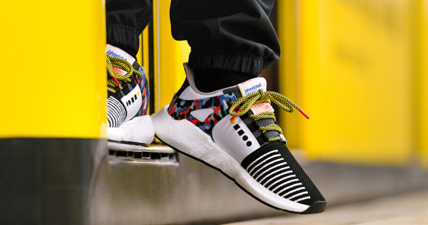 Adidas EQT Support shoes with BVG transport pass closeup