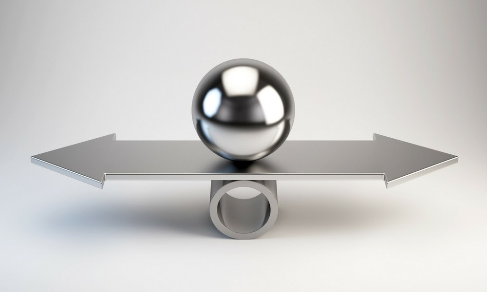 a ball on a balance with arrows pointing in each direction