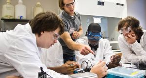 CollegeFirst volunteer oversees CollegeFirst chemistry lab.