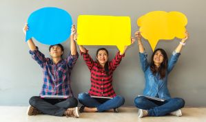 3 people holding up speech bubbles