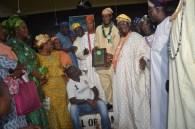 Hadj Sanni Kazeem receiving award from Chief