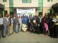 Special Adviser on Communities & Commun ications to the Governor, Hon. Kehinde Bamigbetan (middle) in group photograPH with participants at the workshop