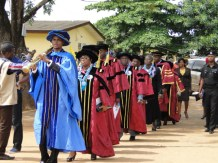 Mace bearer, Mr Clement leading the Principal Officers of the School and the visitor during the procession