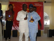 Hon. Agunbiade hugging his counterpart at the federal level after receiving his own Icon award