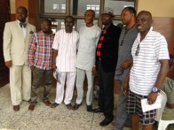 Starlight Publisher, Damola Aderibigbe (3rd L), Keynote speaker, Deen Sanwoola (M), Comrade Taiwo Odumbo (2nd L) and Programme anchor, Mr Bebenlo (L) with members of the planning committe in a group photograph