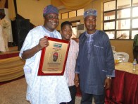 Mr Erogbogbo, with the youngest publisher in Ikorodu, Mr lambo and a friend of the awardee at the ceremony