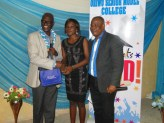 Miss Akinwunmi Olamide, the best student in science receiving her award from Elder Awoye. With them his Oriwu senior Model College Vice Principal