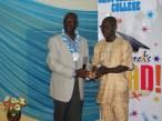 The National Secretary, OCOSAN, Mr Kunle Olambiwoninu recieving an award on behalf of the OCOSAN National President, Alhaji Ganiu Lawa
