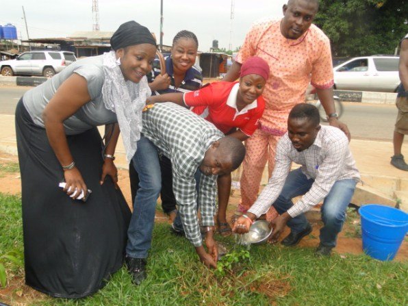 Barr. Oyedepo being assisted by My Ajalogun to plant a tree