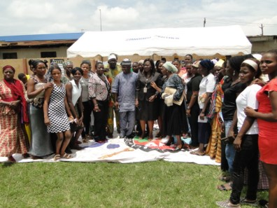 The Majority Leader, Lagos State House of Assembly, Hon. Agunbiade, Representative of the Commissioner for Women Affairs & Poverty Alleviation (WAPA and the )Permanent Secretary, WAPA, Mrs Folashade Adesoye and other guests in group photograph with the beneficiaries