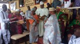 Yeye Tairat Agunbiade receiving recgnition award from Rt. Hon. Obasa