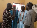 Oba Kasali with Chief Esuluke, Mr Bashiru and Esuleke's aide discussion a matter of importance before the feast