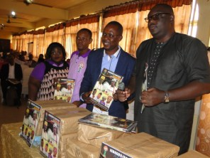 Chief launcher, Otunba Adebowale Okunade (R), Mr Seidu, Mr Anifowoshe and Mrs Mustapha unveiling the magazine