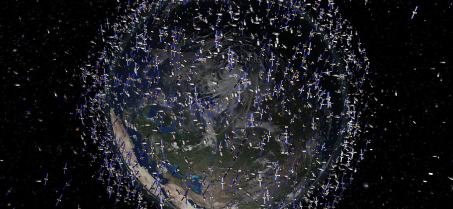 Pictorial representation of planet earth surrounded by thousands of satellites in low earth orbit