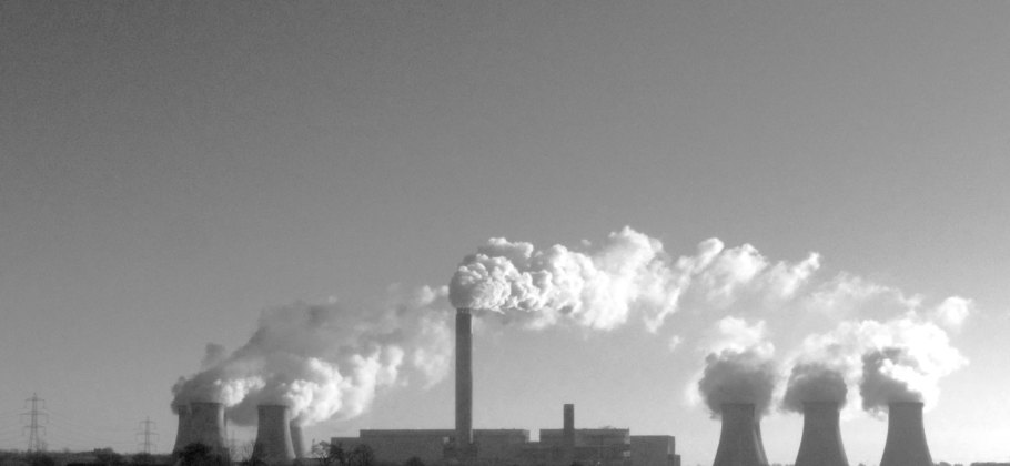 Black and white photograph of Drax power station with its chimney stack in the centre