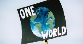 Protest sign saying one earth.
