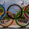Photo of the Olympic rings in front of flags from different countries