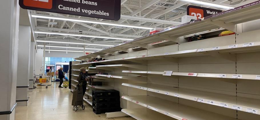 Picture showing empty supermarket shelves