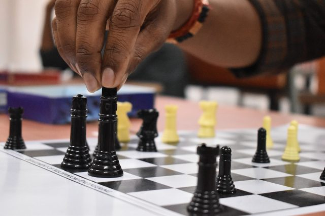 Canva – Black And Yellow Chess Pieces