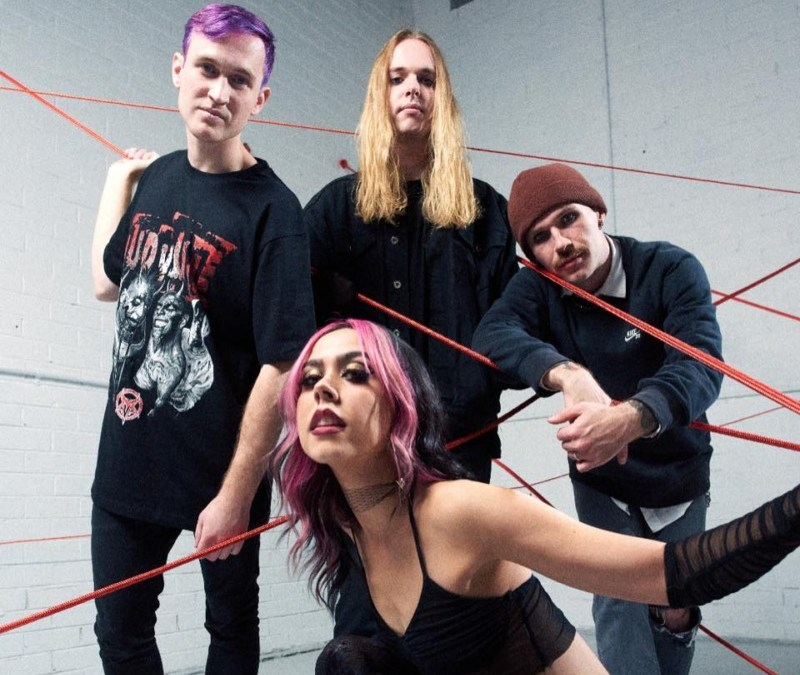 """yours truly get edgy with heartbreak in vibrant, chaotic new music video for """"walk over my grave"""""""