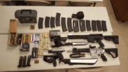 """Weapons arsenal discovered in the vehicle of Scott Edmisten, that includes two """"bump stock"""" equipped AR-15 semi-automatic rifles"""