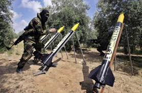 HAMAS fighter gets ready to launch rockets. Not missiles, rockets.