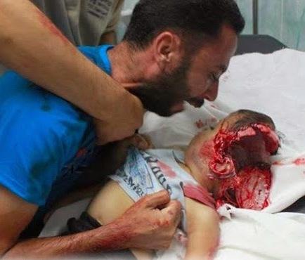 Grief-stricken Palestinian father begs child to wake up