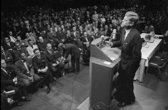 "President Kennedy Warns of ""monolithic and ruthless conspiracy"""