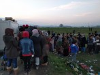 A line forms for ramen noodles from our distribution van at Idomeni camp