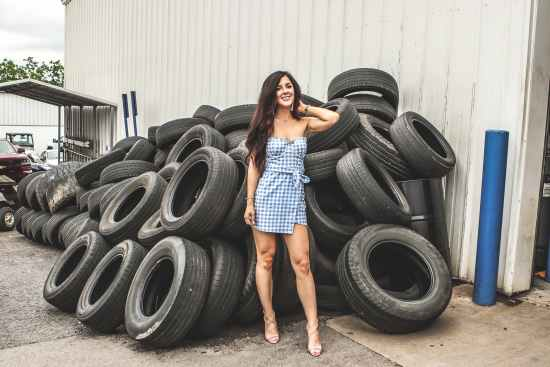 woman posing in front of tires
