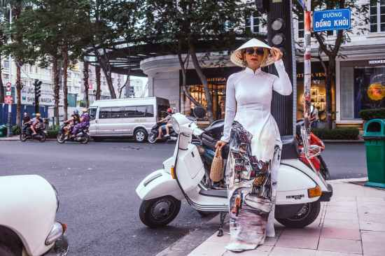 woman standing beside white motor scooter